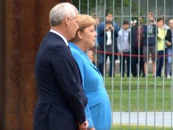 Меркель в третий раз затрясло во время встречи на высшем уровне