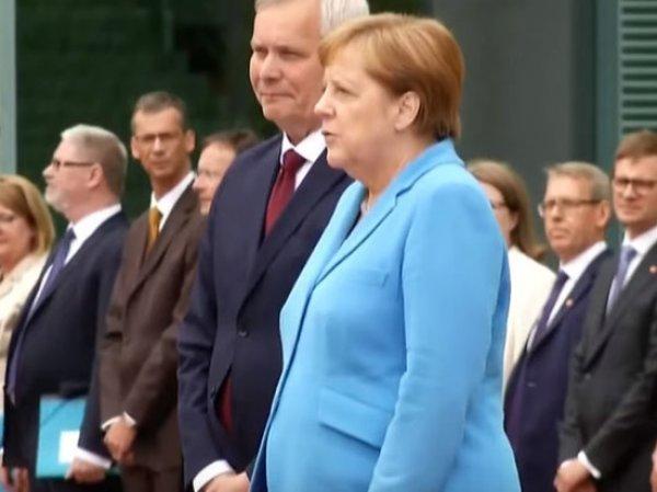 Слова Меркель во время приступа дрожи расшифровали по губам
